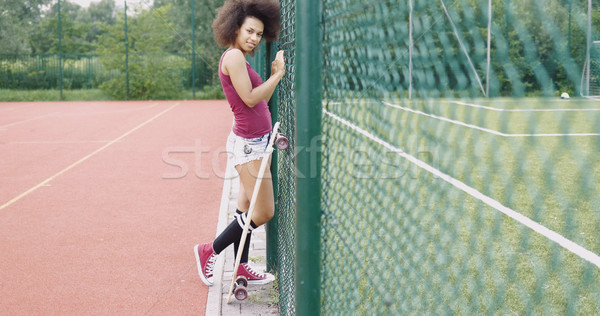 Trendy young girl with longboard Stock photo © dash