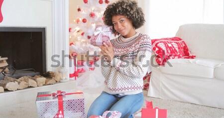 Stylish young woman enjoying her music Stock photo © dash
