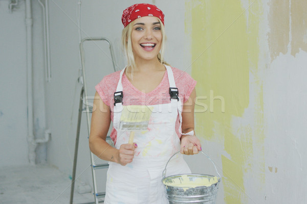 Cheerful woman with brush and paint bucket  Stock photo © dash