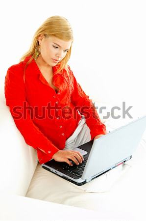 Kadın kırmızı kanepe sörf Stok fotoğraf © dash