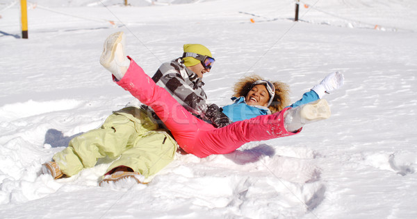 Young couple enjoying a frolic in the snow Stock photo © dash
