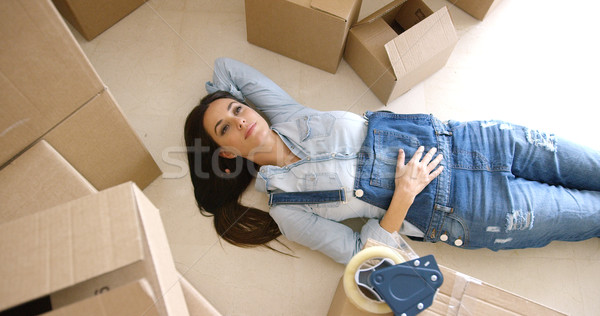 Attractive young woman relaxing on the floor Stock photo © dash