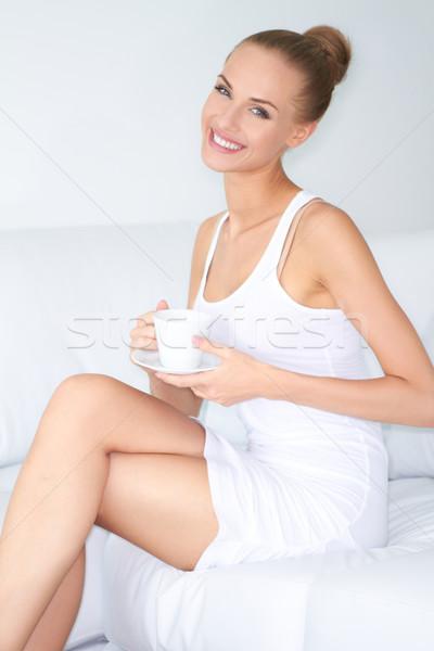 Woman with beautiful smile drinking coffee Stock photo © dash