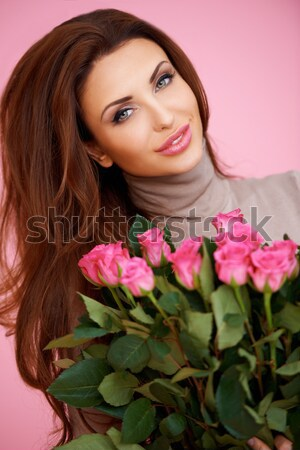 Beautiful seductive woman with roses Stock photo © dash