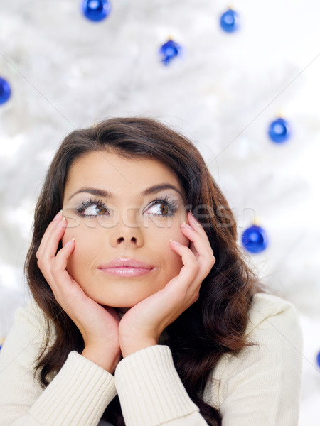 Thoughtful woman in front of a Christmas tree Stock photo © dash