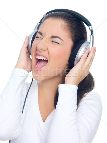 Woman Singing Out Loud While Listening to Music Stock photo © dash