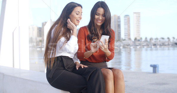 Young woman sharing a text message with friend Stock photo © dash