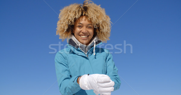 Cute woman in frizzy hair and winter coat Stock photo © dash