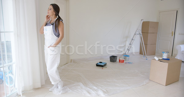 Young woman standing daydreaming at a window Stock photo © dash