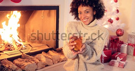 Fun young woman burning a sparkler for Christmas Stock photo © dash