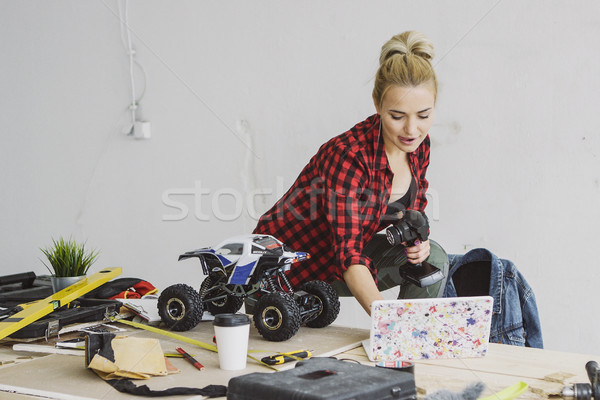 Female with radio-controlled car using laptop Stock photo © dash