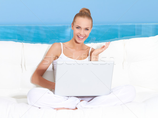 Woman on canopied seat with laptop Stock photo © dash