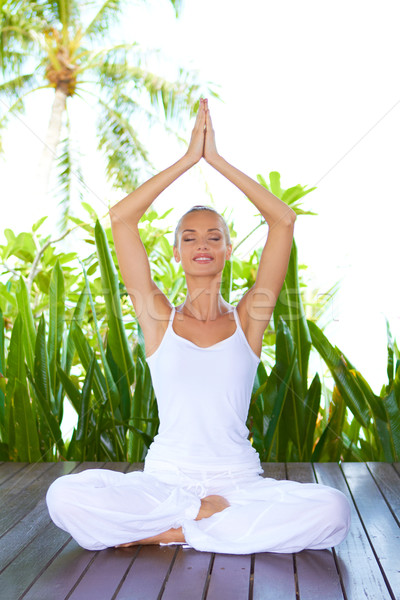 Woman doing yoga breathing exercises Stock photo © dash