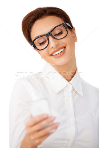 Smiling woman reading a text message Stock photo © dash