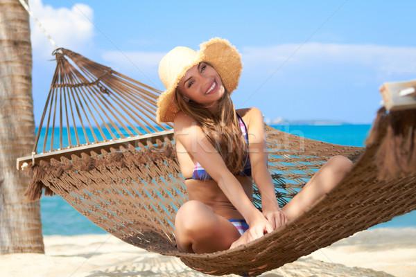 Kobieta uśmiech posiedzenia hamak łaskawy Zdjęcia stock © dash