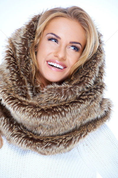 Smiling Blond Woman Wearing Fur Neck Warmer Stock photo © dash