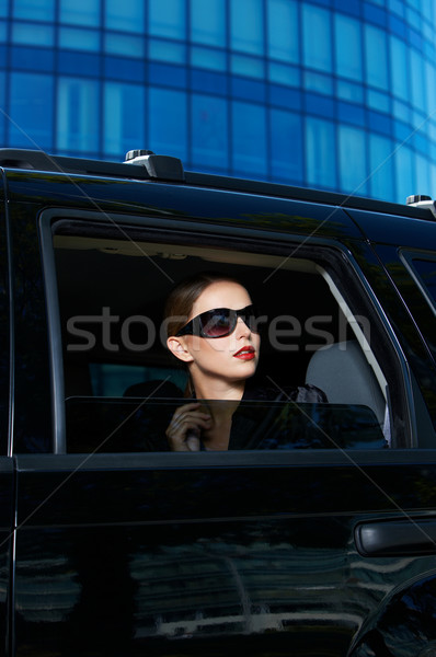 Serious Woman in Shades Inside Expensive Car Stock photo © dash