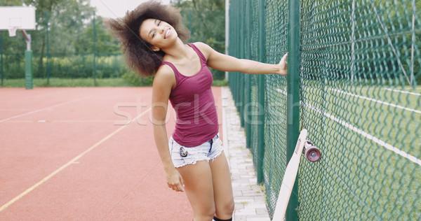 Cheerful woman with longboard Stock photo © dash