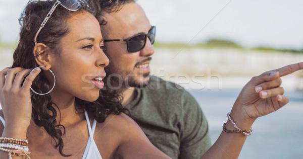 Stylish diverse couple chilling outside Stock photo © dash