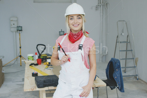 Smiling female carpenter standing at workbench  Stock photo © dash