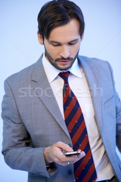 Businessman making a mobile phone call Stock photo © dash
