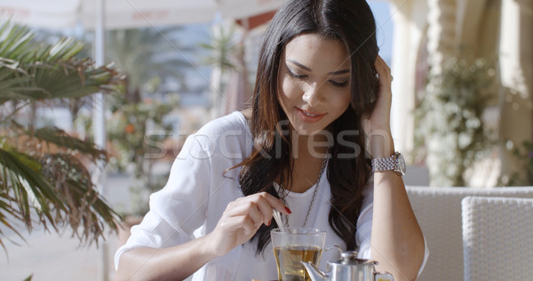 Girl Sitting At Cafe With Cup Of Tea Stock photo © dash