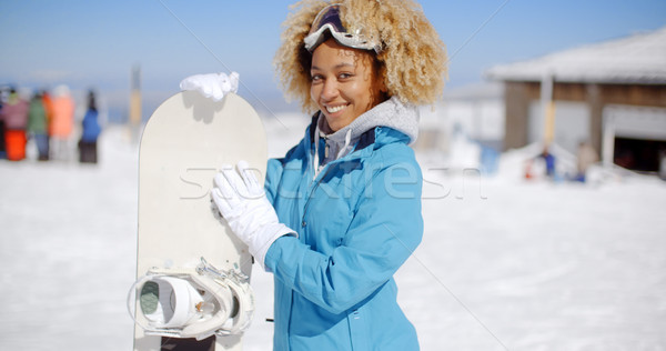 Happy friendly young woman posing with a snowboard Stock photo © dash