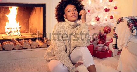 Woman in oversized sweater on bed using laptop Stock photo © dash