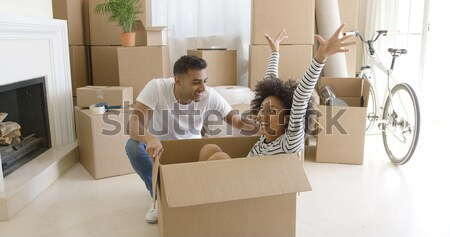 Fun young woman inside a packing box Stock photo © dash