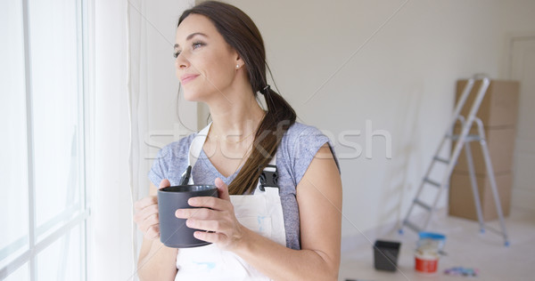 Young woman standing daydreaming Stock photo © dash