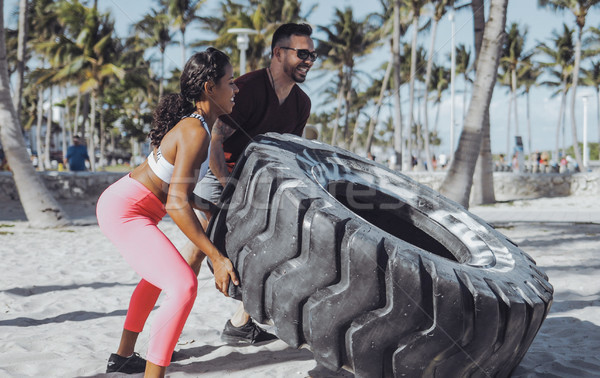 Sportive couple training with tyre together Stock photo © dash