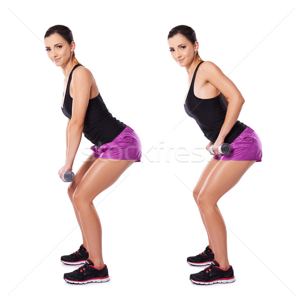 Shapely woman working with dumbbells Stock photo © dash