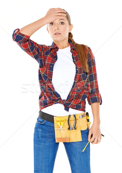 DIY handy woman with a dazed expression Stock photo © dash