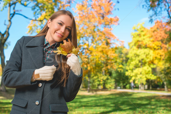 Blond Woman in Gray Coat Holding Dry Leaves Stock photo © dash