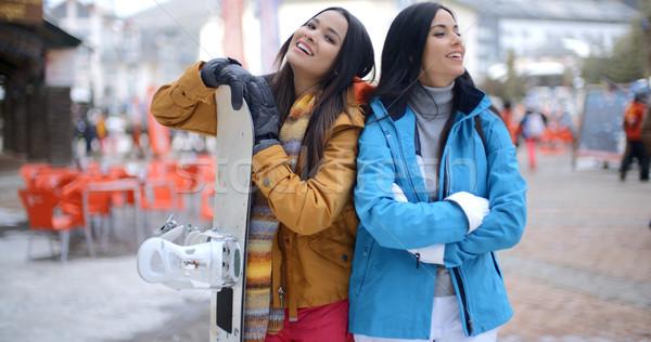 сноуборд сложенный оружия два женщины близнец Сток-фото © dash