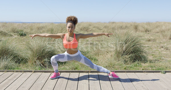 Sporty woman stretching on pavement Stock photo © dash