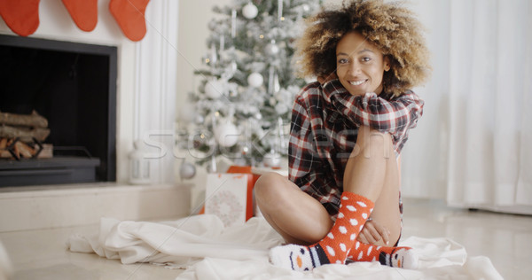 Smiling young woman in a Christmas living room Stock photo © dash