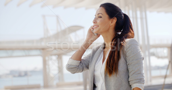 Woman using a mobile in a high key environment Stock photo © dash