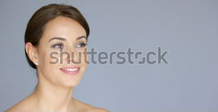 Single gorgeous woman over gray background Stock photo © dash