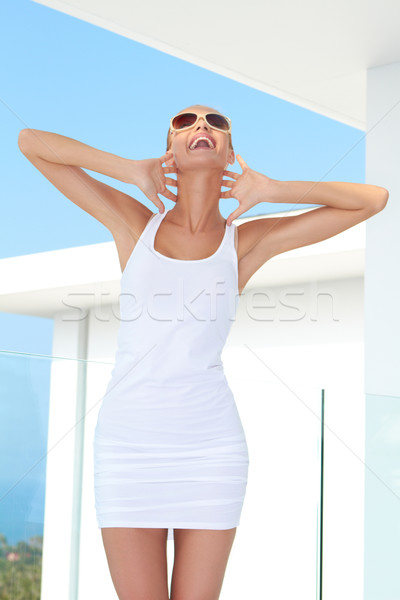 Shapely woman raising her arms in jubilation Stock photo © dash