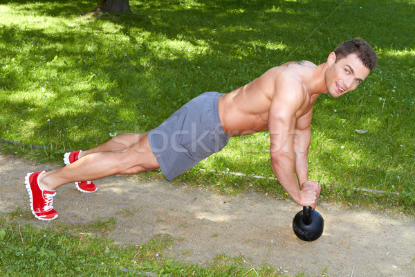 Handsome man exercises with kettlebell Stock photo © dash