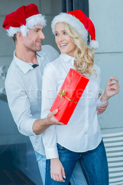 Playful man giving his wife a Christmas gift Stock photo © dash
