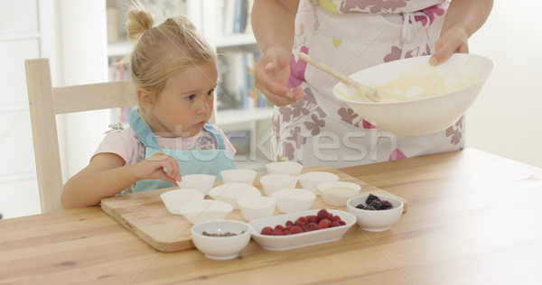 Little girl assisting Mum with the baking Stock photo © dash
