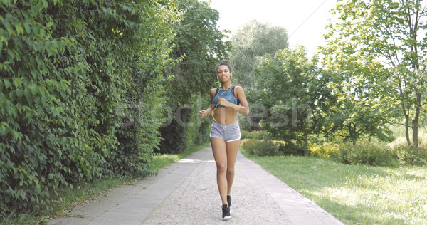 Content woman running in park Stock photo © dash