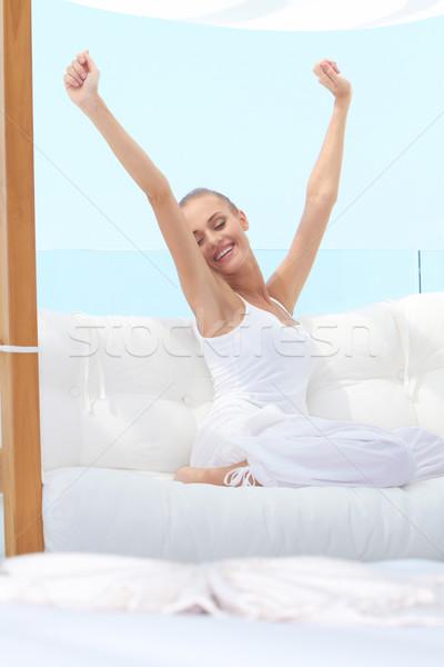 Pretty woman stretching Stock photo © dash