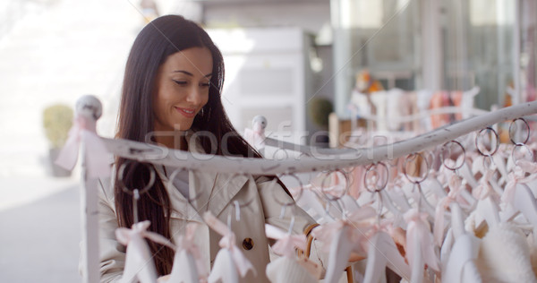 Attractive young woman shopping for clothing Stock photo © dash