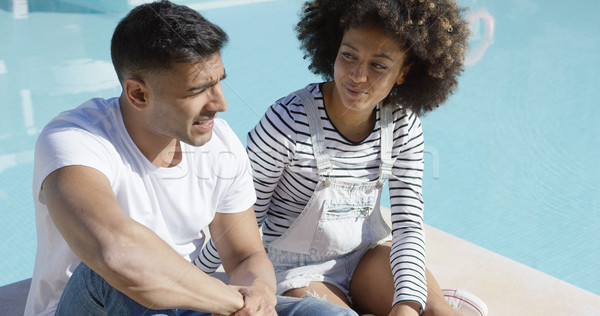 Attractive African couple chatting in the sun Stock photo © dash