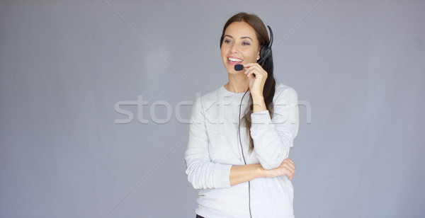 Stock photo: Adorable call center agent speaking with someone on headset