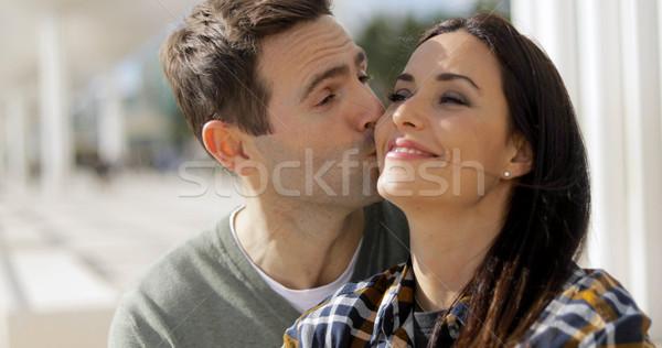Amorous young man kissing his girlfriend Stock photo © dash