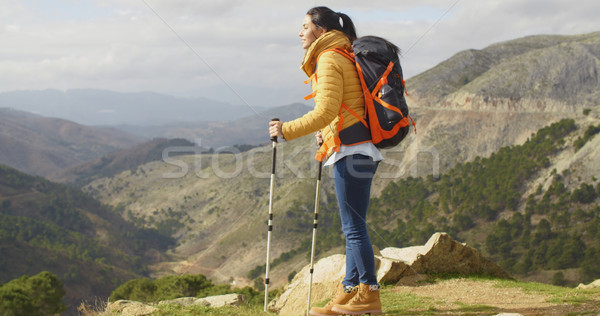 Young woman hiker standing overlooking a valley Stock photo © dash